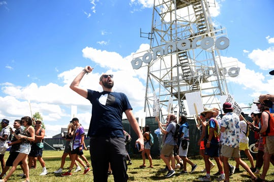 Adam Auctor with the Bunk Police leads a demonstration on drug checking kits in the campgrounds on Thursday during the Bonnaroo Music and Arts Festival in Manchester, Tenn.