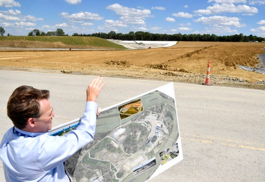 TVA Vice President Scott Turnbow uses an illustration to explain the positioning of the North Rail Loop Landfill at the Gallatin Fossil Plant on June 13, 2019.