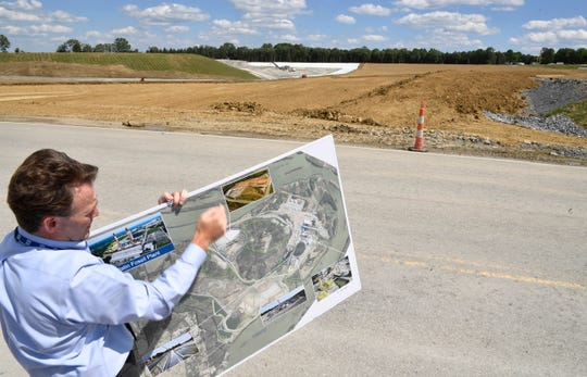 TVA vice president Scott Turnbow shows a photo of the new landfill beside the current landfill at the Gallatin Fossil Plant Thursday, June 13, 2019.