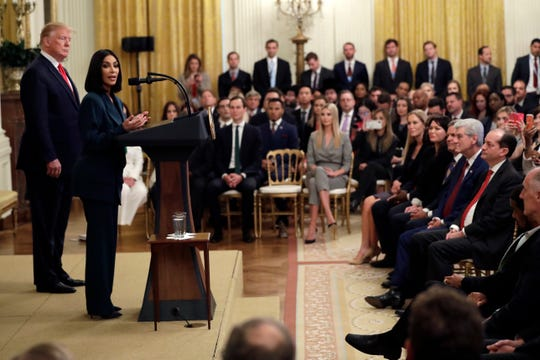 President Donald Trump listens to Kim Kardashian West, who is among the celebrities who have advocated for criminal justice reform, speak during an event on second chance hiring in the East Room of the White House, Thursday, June 13, 2019, in Washington. (AP Photo/Evan Vucci)