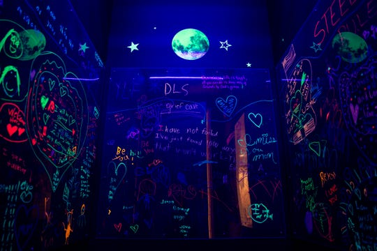 The grief cave, which currently exists in the main Avow Hospice building, will be replicated in Aunt Janet's House, a free-standing children's bereavement center in Naples, photographed on Thursday, June 13, 2019. Children are able to write and draw on the Plexiglass walls of the grief cave with glow in the dark markers, and their writing is illuminated by blacklights. Children that use Avow's services have experienced grief in many forms, including death of a loved one, divorce, incarceration, deployment, and deportation.