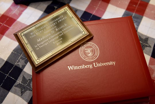 An honor from Wittenberg University's Russian language department awarded to Madison Krstich along with her diploma. Krstich, also a Johnstown alumna, won a Fulbright Scholarship to Uzbekistan, where she will live and teach school for a year.