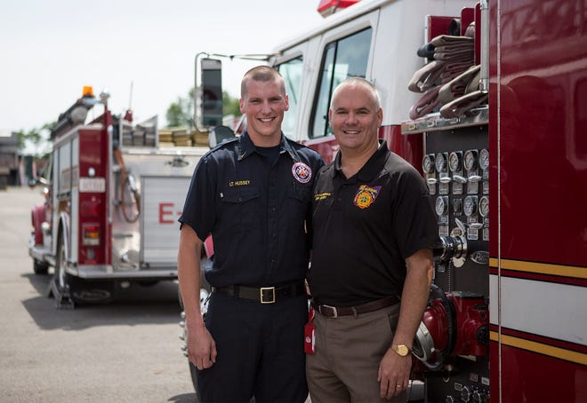 Jeff Hussey, who now serves as Ohio State Fire Marshal, with his son, Ryan Hussey, who followed in his fathers footsteps to not only become a firefighter, but work in the same station his father did, Granville.