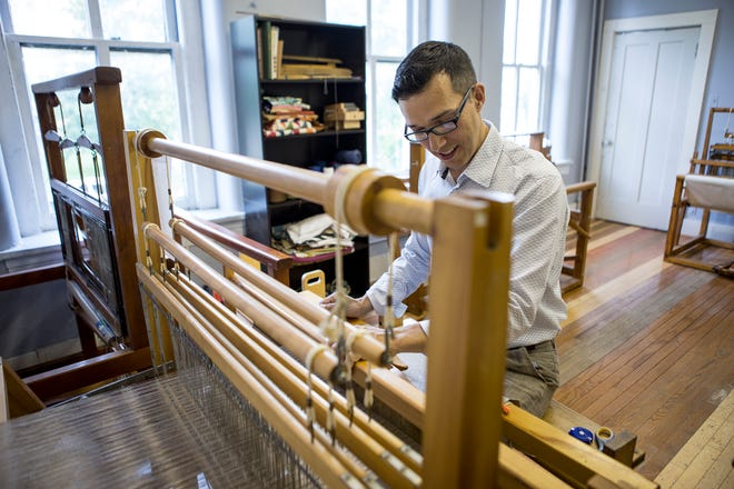 Anton Sarossy-Christon, Director of the Newark Cultural Arts Center located at 17 1/2 South Park Place in Newark works on a loom he uses to teach students weaving at the center. Weaving is one of the many classes available to students. Other options include drawing and tai chi. The course run 8 weeks, but shorter classes are being designed for the summer months. Enrollment is open.