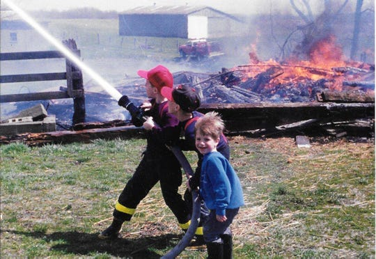 Jeremy and Kyle Weekly, and their cousin, Corey Weekly, as children. All three now serve as firefighters in Ohio.