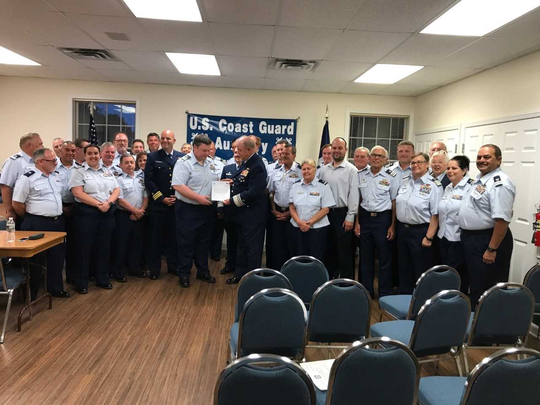Flotilla 10-13 members gather to show off their award as 2018 Coast Guard Auxiliary Flotilla of the Year for the nation.