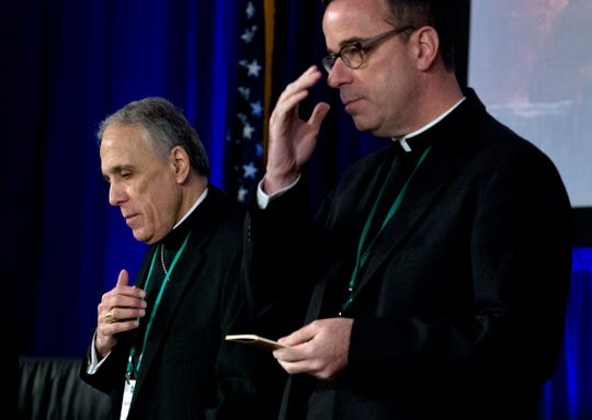Cardinal Daniel DiNardo, left, of the Archdiocese of Galveston-Houston, president of the United States Conference of Catholic Bishops accompanied by Rev. J. Brian Bransfield, participates in a morning prayer, during the United States Conference of Catholic Bishops (USCCB), 2019 Spring meetings in Baltimore, Tuesday, Jun 11, 2019.