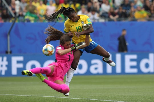 Jamaica goalkeeper Sydney Schneider, left, and Brazil's Ludmila go for the ball during the Women's World Cup Group C soccer match between Brazil and Jamaica in Grenoble, France, Sunday, June 9, 2019.