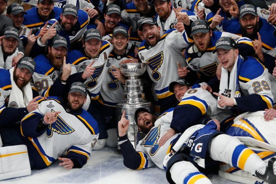 Jun 12, 2019; Boston, MA, USA; St. Louis Blues players pose for a team photo with the Stanley Cup after defeating the Boston Bruins in game seven of the 2019 Stanley Cup Final at TD Garden.