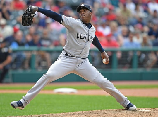 New York Yankees relief pitcher Aroldis Chapman delivers in the ninth inning of a baseball game against the Cleveland Indians, Sunday, June 9, 2019, in Cleveland.