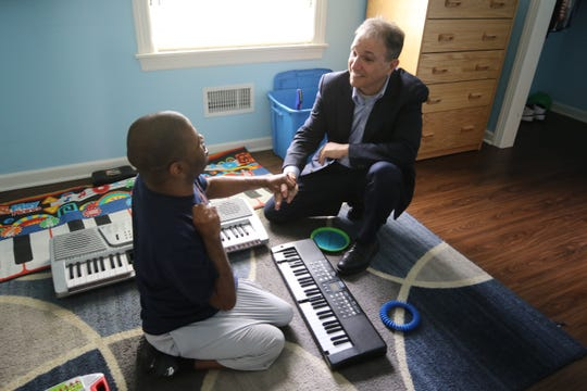 Former Ridgewood Mayor Paul Aronsohn meets with resident Tareem Gary as Aronsohn toured one of the group homes at the Eastern Christian Children's Retreat. Aronsohn was appointed by Gov Murphy as the state's first Ombudsman for Individuals with Intellectual or Developmental Disabilities and their Families. Here on a tour of the Eastern Christian Children's Retreat, a non-profit agency caring for adults with intellectual and developmental disabilities he meets with a resident and Laura Lupica, in charge of recreational aides at the facility.