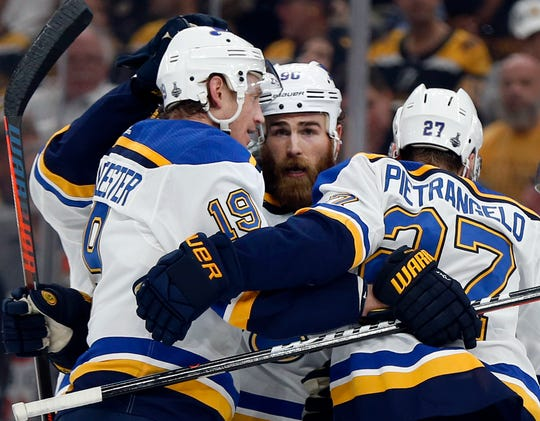 St. Louis Blues' Ryan O'Reilly, center, celebrates his goal with teammates Jay Bouwmeester, left, and Alex Pietrangelo, right. during the first period in Game 7 of the NHL hockey Stanley Cup Final against the Boston Bruins, Wednesday, June 12, 2019, in Boston.