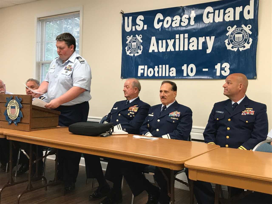Flotilla 10-13 Commander Kevin Fear welcomes National Commander Larry King, Deputy National Commander Gu Formato, and Commander William Grossman, director of the U.S Coast Guard Auxiliary.
