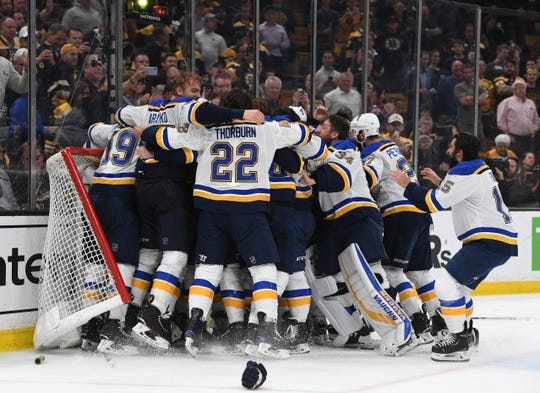 Jun 12, 2019; Boston, MA, USA; St. Louis Blues players celebrate after defeating the Boston Bruins in game seven of the 2019 Stanley Cup Final at TD Garden.