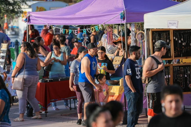 People shop and enjoy the evening farmers market presented by the Farmers and Crafts Market of Las Cruces in Downtown Las Cruces on Wednesday, June 12, 2019.
