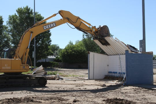 The demolition of the dugouts, fences and press box at Bloomfield High School's old softball field began on Wednesday, June 12.