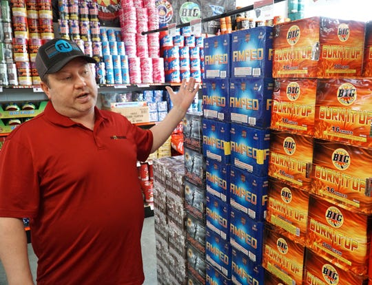 "Westland Big Fireworks manager Sean Conn has aisles and aisles of fireworks, which he describes as those that ""you place on the ground, light the fuse, they go and go boom""."