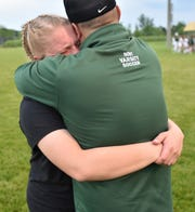 Novi head coach Todd Pheiffer hugs his emotional daughter Abbey - after the Wildcats advanced to the state finals. Abbey was stellar in net most of the year for Novi but had her season ended due to an injury a few weeks ago.