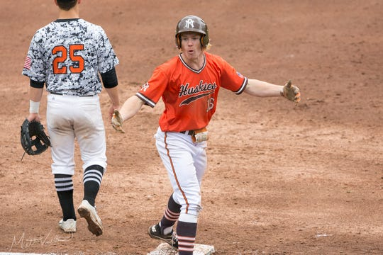 Portage Northern junior Nolan McCarthy celebrates after hitting a triple in the state semi-final against Brother Rice on June 13, 2019.