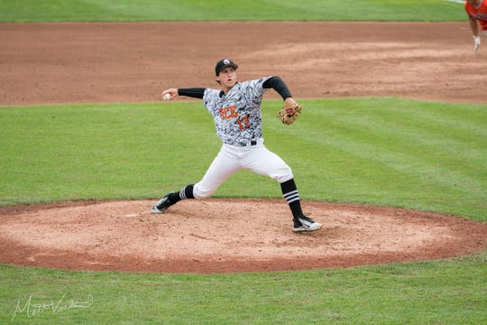 Brother Rice senior Tyler Sarkisian throws a pitch in the state semi-final against Portage Northern on June 13, 2019.