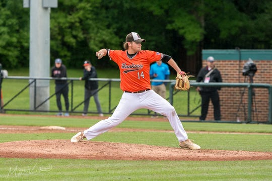 Portage Northern senior Cam French pitches in the state semi-final against Brother Rice on June 13, 2019.