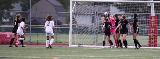 Junior keeper Ashley Bowles made several point-blank saves like this one during the second half and both overtimes.