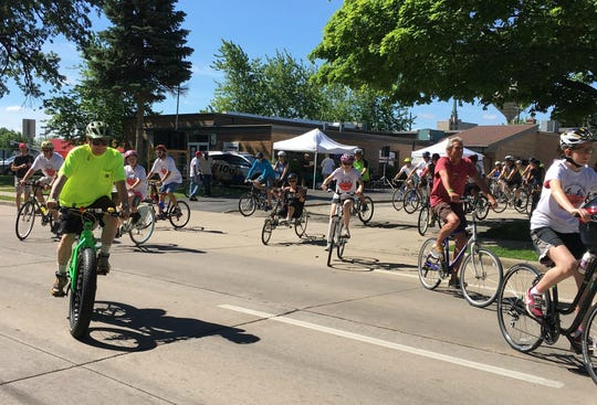 Participants of a past Pedal Out Hunger event begin their ride at The Salvation Army Oshkosh, 417 Algoma Blvd.