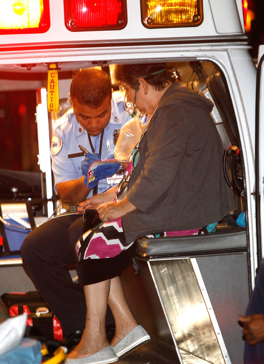 A paramedic treats a victim of an apartment fire at the corner of Sunrise Way and Baristo Road in Palm Springs.