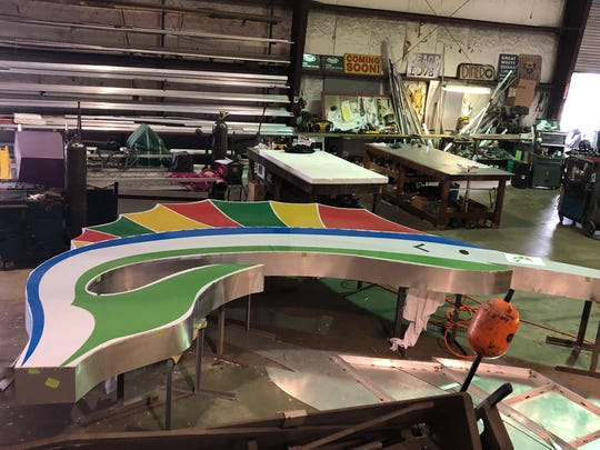 Escambia County Commissioner Robert Bender visited the Daytona Beach workshop where the new Pensacola Beach sailfish welcome sign is being built.