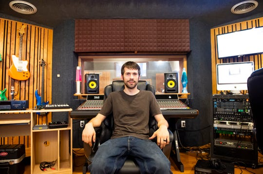Christian Harper, owner of Tone Town Productions, poses for a portrait inside his Hanover recording studio.