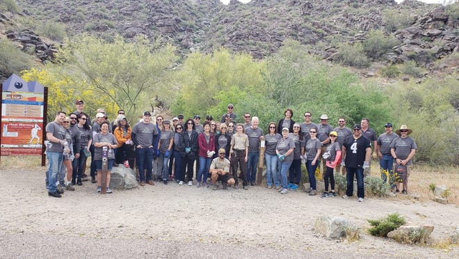 Maracay Homes employee volunteers  participate last month in an Adopt a Trail event at South Mountain.