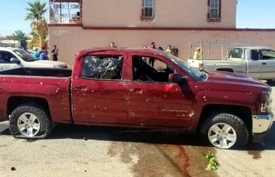 A truck is riddled with bullets in Agua Prieta, Sonora, where a drug-fueled shootout killed nine.