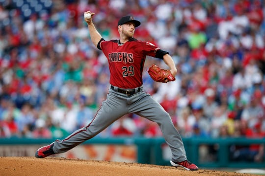 Arizona Diamondbacks' Merrill Kelly pitches during the third inning of a baseball game against the Philadelphia Phillies, Wednesday, June 12, 2019, in Philadelphia.