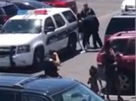 Phoenix mayor apologizes after video shows police pointing gun on family accused of shoplifting
