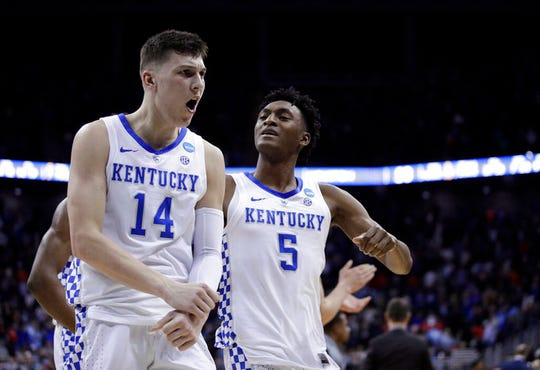 Kentucky's Tyler Herro (14) and Immanuel Quickley celebrate following a men's NCAA tournament college basketball Midwest Regional semifinal game against Houston Friday, March 29, 2019, in Kansas City, Mo. (AP Photo/Charlie Riedel)