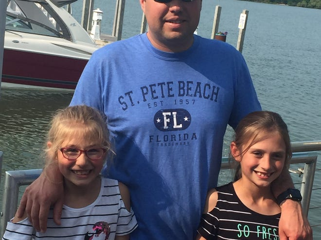 Jeremy Laubacher stands with his daughters. Families in Ottawa County were invited to submit photos of Dads for a photo gallery by The Port Clinton News Herald.