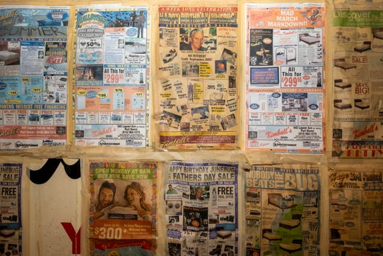 "Newspaper ads for Kimball Appliance hang on a wall in the back of the store. Several ads celebrate Vern ""Junebug"" Norton, who was worked at the store for about 67 years."
