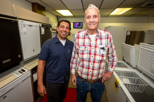 "Kimball Appliance owner Nick Bondarek, left, poses for a photo with Vern ""Junebug"" Norton inside the store Thursday, June 13, 2019. Junebug has been working at Kimball Appliance for about 67 years. Bondarek took over the business in 1998."