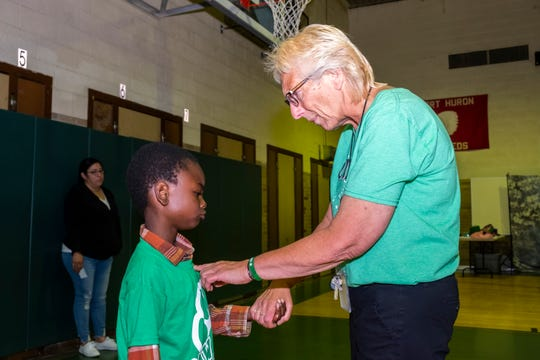 Kimball Elementary principal Kathleen Kish, right, talks with first-grader Isaiah Haller on the last day of school Thursday, June 13, 2019 in the school's gym.