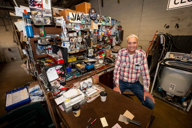 "In the back of Kimball Appliance in Port Huron, Vern ""Junebug"" Norton, 79, sits in his workspace Thursday, June 13, 2019. Nick Bondarek, owner of the store, says some customers won't even look at new appliance because they would prefer a used appliance refurbished by Junebug."