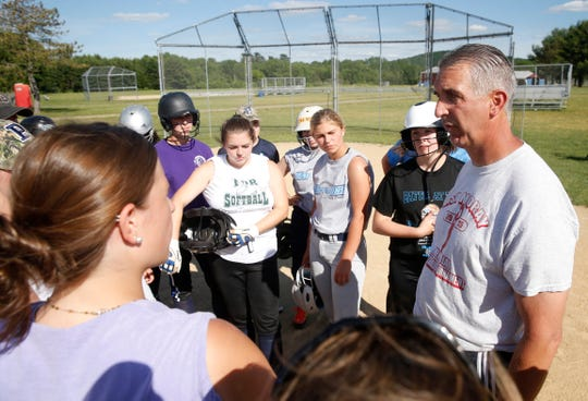 Pine Plains softball coach Les Funk speaks to his players during practice at Stissing Mountain High School on June 12, 2019.