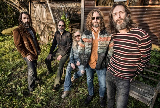 The Chris Robinson Brotherhood, with Chris Robinson on the right and drummer Tony Leone second from right.
