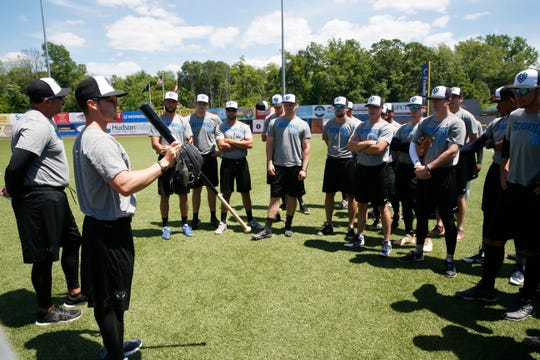 Hudson Valley Renegades manager Blake Butera, at left, gives instructions to his players before practice at Dutchess Stadium in Wappingers Falls on June 12, 2019.