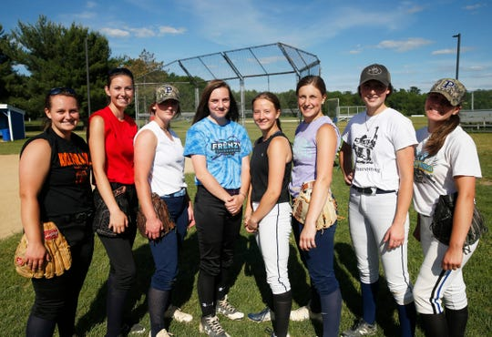 The 8 players from the Pine Plains softball team that are heading to their third state championship tournament, from left, Meg Murray, Sarah Carver, Alex McKenzie, Kris Wilson, Paige Tegtmeier, Jo Schmidt, Haley Strang and Lourdes Belanger after practice at Stissing Mountain High School on June 12, 2019.