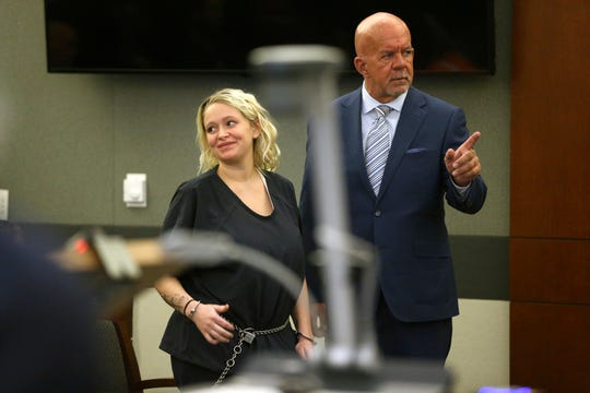Kelsey Turner, left, with her attorney Brian Smith, appears for her court hearing where she pleaded not guilty to a murder charge in the death of a California psychiatrist, at the Regional Justice Center in Las Vegas, Thursday, June 13, 2019. (Erik Verduzco/Las Vegas Review-Journal via AP)