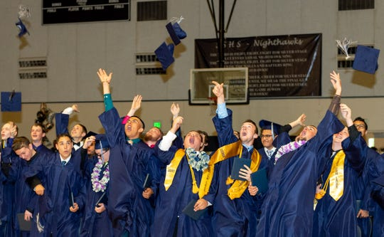 Graduates celebrate at the completion of the commencement exercises.
