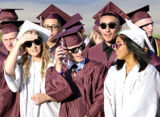 Sunglasses were the order of the day for Alyssa Zubieta (left) and her fellow graduates.