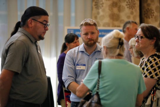 Representatives from PG&E speak with North State residents at an open house at the Red Lion Hotel in Redding on Tuesday, June 11.