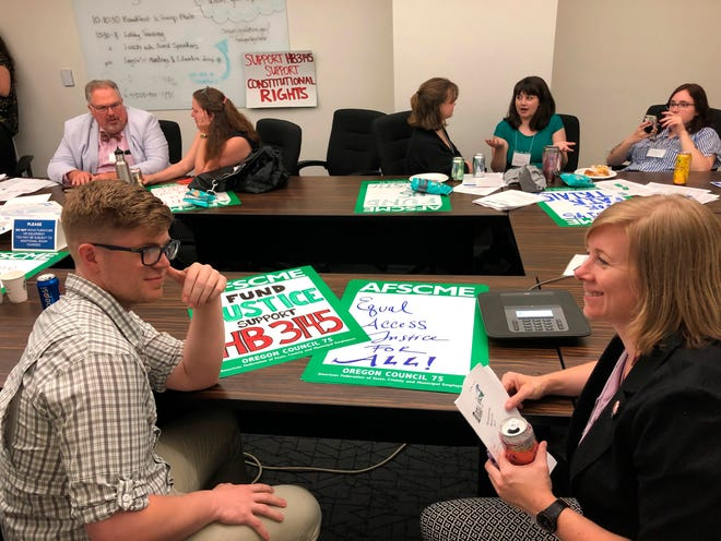 Public defenders in Oregon strategize at the Oregon Capitol in Salem, Oregon before lobbying lawmakers to pass legislation that would overhaul the public defender system in the state.