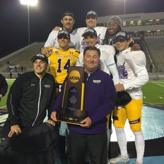 Bronte native and former Angelo State University football player Stephen Lee holds the trophy after coaching in the 2018 NCAA Division III national championship game.